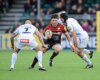 20130216 Copyright onEdition 2013©.Free for editorial use image, please credit: onEdition..Ernst Joubert of Saracens looks for a gap between James Scaysbrook (left) and Dean Mumm of Exeter Chiefs during the Premiership Rugby match between Saracens and Exeter Chiefs at Allianz Park on Saturday 16th February 2013 (Photo by Rob Munro)..For press contacts contact: Sam Feasey at brandRapport on M: +44 (0)7717 757114 E: SFeasey@brand-rapport.com..If you require a higher resolution image or you have any other onEdition photographic enquiries, please contact onEdition on 0845 900 2 900 or email info@onEdition.com.This image is copyright onEdition 2013©..This image has been supplied by onEdition and must be credited onEdition. The author is asserting his full Moral rights in relation to the publication of this image. Rights for onward transmission of any image or file is not granted or implied. Changing or deleting Copyright information is illegal as specified in the Copyright, Design and Patents Act 1988. If you are in any way unsure of your right to publish this image please contact onEdition on 0845 900 2 900 or email info@onEdition.com