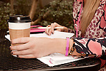 November 27, 2012. Charleston, South Carolina.. The latte, and jewelry, of Alexa Wyatt as she meets with another wedding planner at Kudu, a downtown coffee shop. . Alexa Wyatt, 23, is an Event Coordinator with Southern Protocol, a boutique wedding and event planning company in Charleston, SC..
