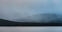 Faint, rainy moody sunset at Lake Te Anau with Kepler Mountains in background, Fiordland National Park, UNESCO World Heritage Area, Southland, New Zealand, NZ
