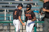 Modesto Nuts right fielder Gareth Morgan (44) receives a high five from manager Mitch Canham (6) after hitting a home run during a California League game against the San Jose Giants at John Thurman Field on May 9, 2018 in Modesto, California. San Jose defeated Modesto 9-5. (Zachary Lucy/Four Seam Images)