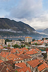 The walled city of Kotor, with the new city beyond its walls on the Bay of Kotor, Montenegro