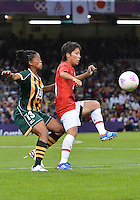July 31, 2012..South Africa's Gabisile Hlumbane (13) and Japan's Mana Iwabuchi (16) in action during Football match between JPN and RSA at the Millennium Stadium on day four of 2012 Olympic Games in Cardiff, United Kingdom...