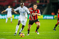 ( L-R ) Modou Barrow of Swansea City and Harry Arter of Bournemouth in action during the Premier League match between Swansea City and Bournemouth at The Liberty Stadium, Swansea, Wales, UK. Saturday 31 December 2016