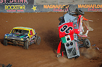 Dec. 11, 2011; Chandler, AZ, USA; LOORRS pro two unlimited driver Rodrigo Ampudia (right) crashes as Rob Naughton avoids on the outside during the Lucas Oil Challenge Cup at Firebird International Raceway. Mandatory Credit: Mark J. Rebilas-