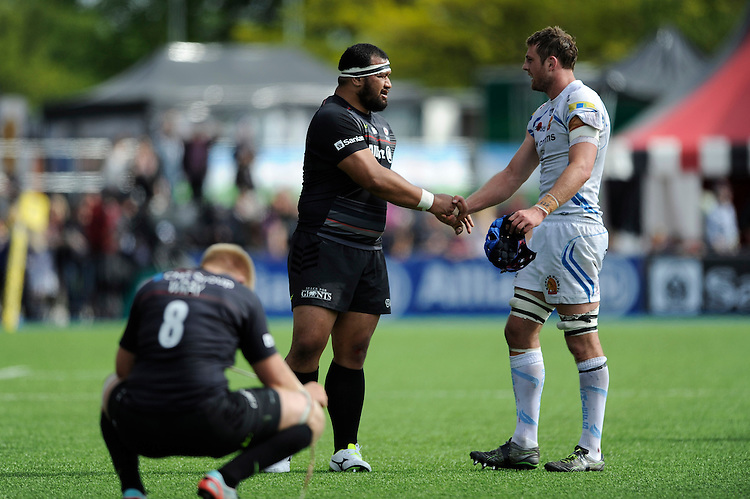 Dean Mumm of Exeter Chiefs shakes hands with James Johnston of Saracens as Jackson Wray of Saracens shows disappointment after losing