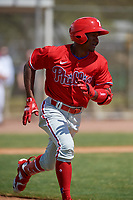 Philadelphia Phillies Johan Rojas (33) runs to first base during an exhibition game against the Canada Junior National Team on March 11, 2020 at Baseball City in St. Petersburg, Florida.  (Mike Janes/Four Seam Images)