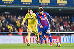Lionel Andres Messi (r) of FC Barcelona fights for the ball with Nicola Sansone of Villarreal CF during their La Liga match between Villarreal and FC Barcelona at the Estadio de la Cerámica on 08 January 2017 in Villarreal, Spain. Photo by Maria Jose Segovia Carmona / Power Sport Images