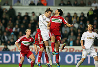 Wednesday, 12 December 2012<br /> Pictured: Michu of Swansea (L) battles for a header against George Friend (R)<br /> Re: Capital One Cup, fifth round, Swansea City FC v Middlesbrough at the Liberty Stadium, south Wales.