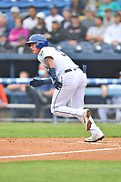 Asheville Tourists Korey Lee (5) runs to first base during a game against the Greenville Drive on May 18, 2021 at McCormick Field in Asheville, NC. (Tony Farlow/Four Seam Images)