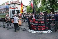 """Etwa 45 Neonazis protestierten am Freitag den 8. Mai 2015 in Berlin-Karlshorst gegen die Feierlichkeiten zum 70. Jahrestag der Befreiung Deutschlands vom Nationalsozialismus. Die Neonazis hielten unweit des Kapitulationsmuseum eine Kundgebung ab. Sie feierten in Reden die Helden der Wehrmacht und behaupteten, die Allierten haetten nach der Kapitulation ueber 1 Million Deutsche ermordet und der """"Voelkermord"""" ginge heute durch Einwanderung weiter.<br /> Im Bild: Am Rednerpult steht der Rechtsanwalt Wolfram Nahrath, Verteidiger des im NSU-Prozess angeklagten Neonazi  Ralf Wohlleben. Nahrath war bis zum ihrem Verbot 1994 Anfuehrer der Neonaziorganisation Wiking Jugend, die Kinder und Jugendliche nach dem Vorbild der Hitlerjugend erzog.<br /> 8.5.2015, Berlin<br /> Copyright: Christian-Ditsch.de<br /> [Inhaltsveraendernde Manipulation des Fotos nur nach ausdruecklicher Genehmigung des Fotografen. Vereinbarungen ueber Abtretung von Persoenlichkeitsrechten/Model Release der abgebildeten Person/Personen liegen nicht vor. NO MODEL RELEASE! Nur fuer Redaktionelle Zwecke. Don't publish without copyright Christian-Ditsch.de, Veroeffentlichung nur mit Fotografennennung, sowie gegen Honorar, MwSt. und Beleg. Konto: I N G - D i B a, IBAN DE58500105175400192269, BIC INGDDEFFXXX, Kontakt: post@christian-ditsch.de<br /> Bei der Bearbeitung der Dateiinformationen darf die Urheberkennzeichnung in den EXIF- und  IPTC-Daten nicht entfernt werden, diese sind in digitalen Medien nach §95c UrhG rechtlich geschuetzt. Der Urhebervermerk wird gemaess §13 UrhG verlangt.]"""
