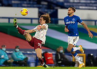 19th December 2020, Goodison Park, Liverpool, England;  Arsenals David Luiz clears the ball under pressure from Evertons Dominic Calvert-Lewin during the Premier League match between Everton FC and Arsenal FC which edned 2-1