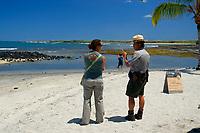 Park Ranger giving information to a visitor, Kaloko-Honokohau National Historical Park, Kailua Kona, Big Island, Hawaii, USA, Pacific Ocean