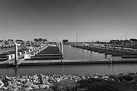 Out of at least 60 berths visible, only a handful of boats are moored in a section of the San Leandro Marina in this black and white image taken May 3, 2021.