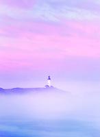 Yaquina Lighthouse, fog and sunrise. Oregon.