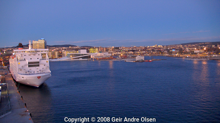 Oslo harbor, with the brand new opera-house in the background at sundown.