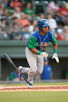 Third baseman Carlos Diaz (14) of the Lexington Legends runs to first base during a game against the Greenville Drive on Saturday, September 1, 2018, at Fluor Field at the West End in Greenville, South Carolina. Greenville won, 9-6. (Tom Priddy/Four Seam Images)