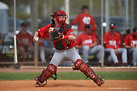Canada Junior National Team catcher Russell Young (37) throws down to second base during an exhibition game against the Toronto Blue Jays on March 8, 2020 at Baseball City in St. Petersburg, Florida.  (Mike Janes/Four Seam Images)