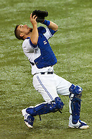 Toronto Blue Jays catcher Jeff Mathis #6 catches a pop up foul ball during an American League game against the Seattle Mariners at the Rogers Centre on September 13, 2012 in Toronto, Ontario.  Toronto defeated Seattle 8-3.  (Mike Janes/Four Seam Images)
