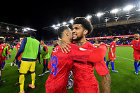 ORLANDO, FL - NOVEMBER 15: DeAndre Yedlin #2 and Sergino Dest #18 of the United States celebrate during a game between Canada and USMNT at Exploria Stadium on November 15, 2019 in Orlando, Florida.
