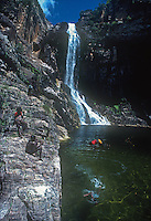 Tribal Aboriginal Children playing at a Waterfall in Arnhem Land,Northern Territory, Australia