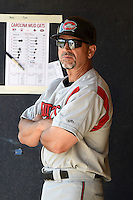 Carolina Mudcats manager Scooter Tucker (16) in the dugout during a game against the Frederick Keys on April 26, 2014 at Harry Grove Stadium in Frederick, Maryland.  Carolina defeated Frederick 4-2.  (Mike Janes/Four Seam Images)