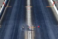 Jun 17, 2016; Bristol, TN, USA; NHRA funny car driver Jim Campbell crosses the center line and hits the foam timing blocks during qualifying for the Thunder Valley Nationals at Bristol Dragway. Mandatory Credit: Mark J. Rebilas-USA TODAY Sports