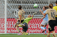 Christine Sinclair (12) shoots against Jillian Loyden. The Chicago Red Stars defeated FC Gold Pride 1-0 at Totyota Park in Bridgeview, Illinois on May 29th, 2010.