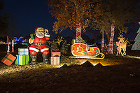 Santa and Rudolf visit the Zilker Park Trail of Lights with a sled full presents