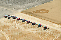 Harvestors lined up and ready to roll. Elbert County, Colorado. July 2014