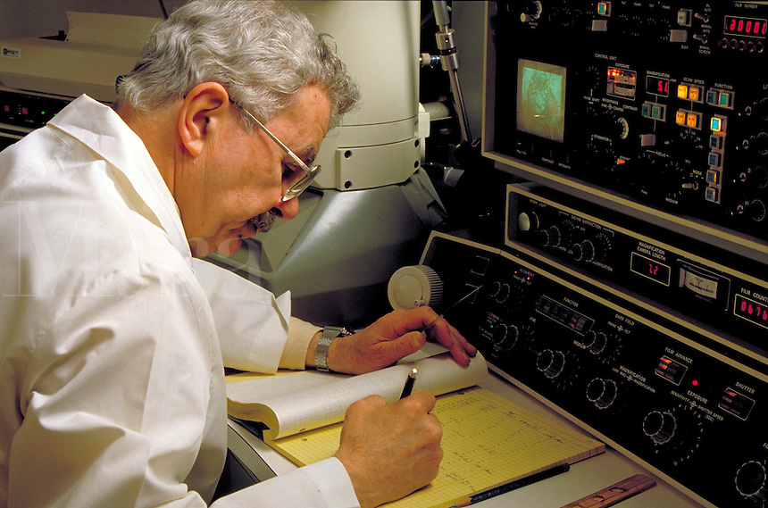 Researcher at an electron microscope.