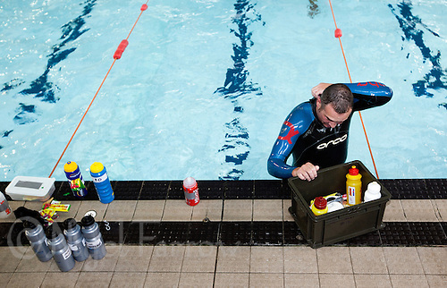 07 AUG 2010 - LICHFIELD, GBR - Scott Markham prepares to leave the pool after completing the 7.2 mile, 456 length swim of the Triple Iron race at the Enduroman Ultra Triathlon Championships .(PHOTO (C) NIGEL FARROW)