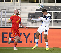 1st September 2021: Helsinki, Finland; Jonny Williams of Wales and Finlands Jasin Assehnoun challenge for the ball during the International Friendly,   Finland versus Wales at the Helsinki Olympic Stadium
