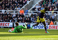 Pictured: Wilfried Bony of Swansea (R) is denied a goal by Newcastle goalkeeper Tim Krul (L). Saturday 19 April 2014<br /> Re: Barclay's Premier League, Newcastle United v Swansea City FC at St James Park, Newcastle, UK.