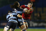 Munster number 8 Robin Copeland takes on Blues back row pair Josh Turnbull and Josh Navidi.<br /> Guiness Pro12<br /> Cardiff Blues v Munster<br /> Cardiff Arms Park<br /> 01.11.14<br /> ©Steve Pope-SPORTINGWALES