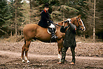 Quantock Staghounds 1990s Uk. Quantock Hills Somerset. Woman on horse back with man with binoculars trying to find the hunt. 1997