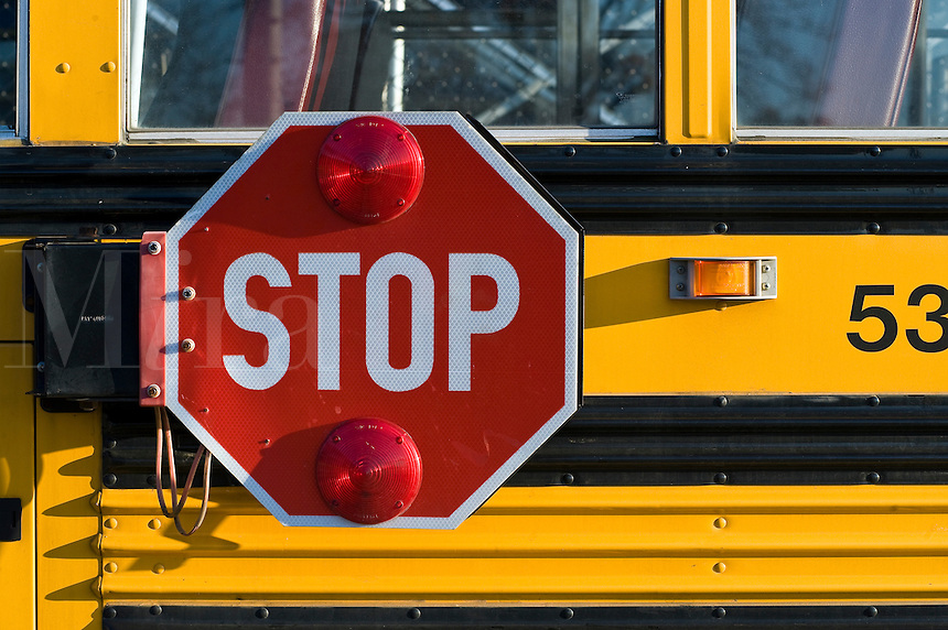 School bus with retracting safety stop sign.
