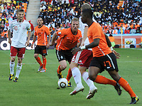 Holland's Dirk Kuyt looks to get ball to Elijero Elia making a run off the left flank. Holland defeated Denmark, 2-0, June 14th, at Soccer City in the opening match of Group E of the 2010 FIFA World Cup.