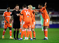 Blackpool players question Referee Ollie Yates' decision to only show Peterborough United's Dan Butler a yellow <br /> <br /> Photographer Chris Vaughan/CameraSport<br /> <br /> The EFL Sky Bet League One - Peterborough United v Blackpool - Saturday 21st November 2020 - London Road Stadium - Peterborough<br /> <br /> World Copyright © 2020 CameraSport. All rights reserved. 43 Linden Ave. Countesthorpe. Leicester. England. LE8 5PG - Tel: +44 (0) 116 277 4147 - admin@camerasport.com - www.camerasport.com
