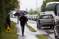 Friday 23 May 2014, Hay on Wye UK<br /> Pictured: A mane with an umbrellas arriving in the pouring rain.<br /> Re: The Telegraph Hay Festival, Hay on Wye, Powys, Wales UK.