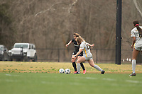 LOUISVILLE, KY - MARCH 13: Savannah McCaskill #7 of Racing Louisville FC and Julianne Vallerand #26 of West Virginia University battle for the ball during a game between West Virginia University and Racing Louisville FC at Thurman Hutchins Park on March 13, 2021 in Louisville, Kentucky.
