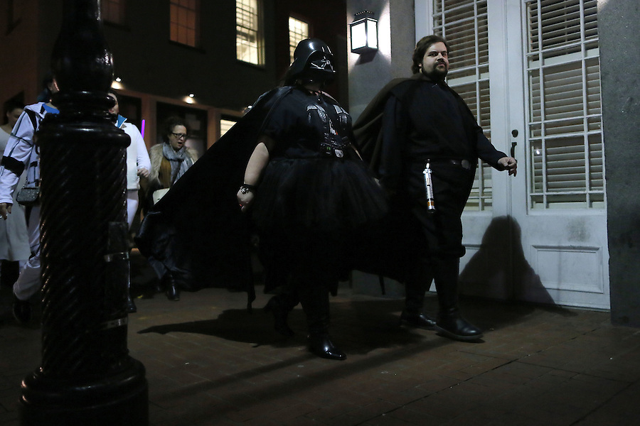 """Members of Krewe of Chewbacchus parade through the French Quarter, Thursday, Dec. 17, 2015, in New Orleans. Krewe of Chewbacchus, a Mardi Gras parade club is celebrating the premiere of the latest """"Star Wars"""" movie with costumes, a brass band and a parade through the French Quarter. (AP Photo/Jonathan Bachman)"""