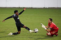 RICHMOND, VA - SEPTEMBER 30: Serge Ngoma #81 of New York Red Bulls II and Alex Tambakis #1 of North Carolina FC challenge for the ball during a game between North Carolina FC and New York Red Bulls II at City Stadium on September 30, 2020 in Richmond, Virginia.