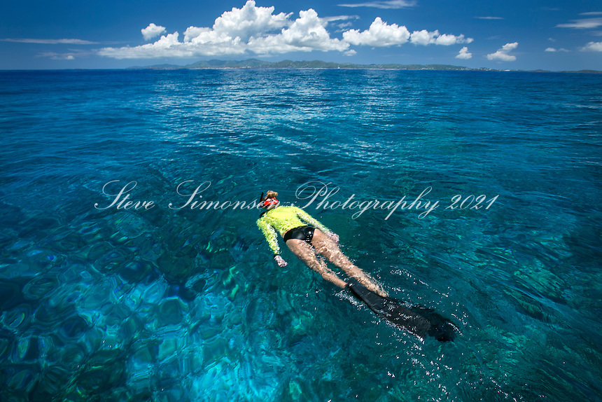 Snorkeler with St. John in the distance<br /> Virgin Islands