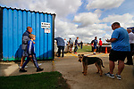One man and a dog wait for kick off. Kettering Town 1 Leiston 2, Evo Stick Southern League Premier Central, Latimer Park. Kettering Town are a famous name in non-league football. After financial problems, relegations, and relocation, the club are once again upwardly mobile. Despite losing to Leiston, Kettering finished the season as Champions and were promoted to the National League North.