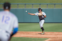 Surprise Saguaros shortstop Cole Tucker (2), of the Pittsburgh Pirates organization, throws to first base during an Arizona Fall League game against the Salt River Rafters at Salt River Fields at Talking Stick on November 5, 2018 in Scottsdale, Arizona. Salt River defeated Surprise 4-3 . (Zachary Lucy/Four Seam Images)