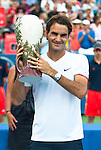 Roger Federer of Switzerland holding the trophy after winning a record fifth Western & Southern Open in Mason, OH on August 19, 2012.