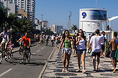 Rio de Janeiro, Brazil. Crowded Ipanema cycle lane and pavement by Posto 9.