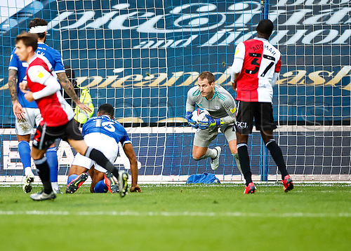 31st October 2020; The Kiyan Prince Foundation Stadium, London, England; English Football League Championship Football, Queen Park Rangers versus Cardiff City; Goalkeeper  Alex Smithies of Cardiff City holding tight while saving yet another attack