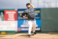 Everett AquaSox pitcher Steve Ewing #45 toes the rubber during a game against the Spokane Indians at Everett Memorial Stadium on June 24, 2012 in Everett, WA.  Spokane defeated Everett 11-2.  (Ronnie Allen/Four Seam Images)