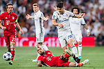 Marco Asensio Willemsen (r) of Real Madrid fights for the ball with Arturo Vidal of FC Bayern Munich during their 2016-17 UEFA Champions League Quarter-finals second leg match between Real Madrid and FC Bayern Munich at the Estadio Santiago Bernabeu on 18 April 2017 in Madrid, Spain. Photo by Diego Gonzalez Souto / Power Sport Images
